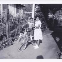 Vincent on Bike w Lily c1952.jpg